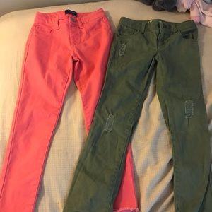 2 pair of girls skinny jeans.